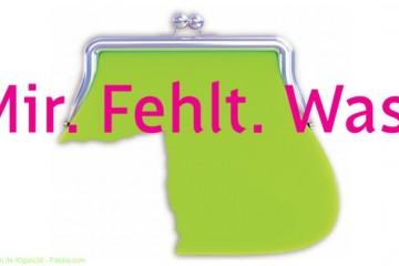 Grüne Geldbörse, der ein Viertel fehlt, Pinker Schriftzug Mir.Fehlt.Was. - Aktion der BAG gegen Altersarmut bei Frauen