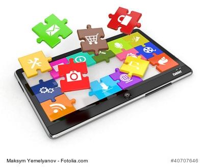 Tablet mit App-Puzzle-Teilchen