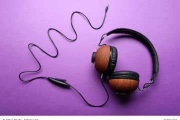 Black and brown headphones on purple background