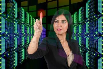Woman using touch screen interface in modern data center